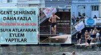 Gent şehrinde yaklaşık 100  kişi daha fazla yüzülebilir alan için suya atlayarak eylem yaptı.